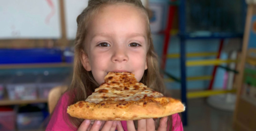 cute girl eating pizza