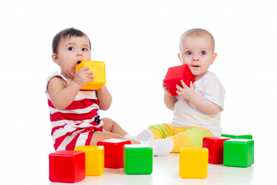 two toddlers playing toys